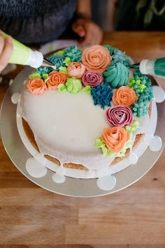 Beautiful buttercream flower cake by Molly Yeh - from mynameisyeh.com