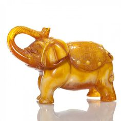 https://www.liveauctioneers.com/item/36919845_carved-amber-circus-elephant-trunk-up-4x7