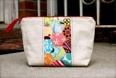 Pretty hexagon pouch. Cute idea. ?Paper piecing insert?