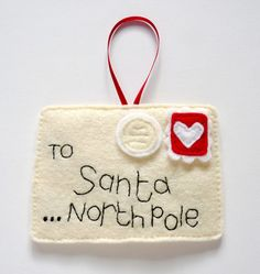 felt santa letter ornament-something like this would be cute to make with a pocket in the back to put the current Santa letter in. Then hang it on the tree or on a doorknob. One of Santa's elves can then take the letter....
