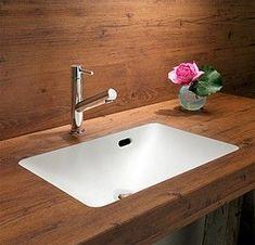 グッドデザイン賞のアイリッシュカウンター。メラミンカウンターに人工大理石の洗面ボウルを一体成形するデザイン(アイカ工業)