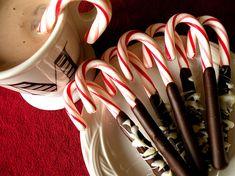 Chocolate dipped candy cane stir sticks.