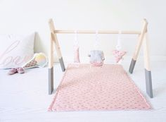 Our handmade wooden play gym is a perfect place to stimulate babys senses but is also designed to look aesthetically pleasing in your home. Liapela.com