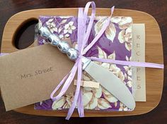 Hostess gift idea:  A small cheese board with cocktail napkins and a sleeve of recipe cards with cheese ball recipes and wine pairing suggestions.