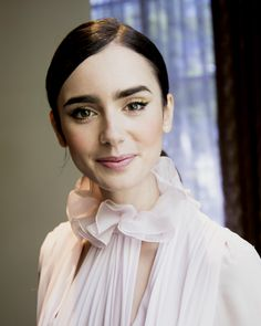 Lily Collins at the 'Rules Don't Apply' Press Conference at the Four Seasons Hotel in Beverly Hills, California. (October 6, 2016)
