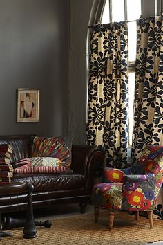 "love this boho look with the leather couch. loving all the textile patterns in this room. Anthropologie ""Cotswold"" sofa, pic 2 of 3"