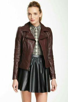 Black skater miniskirt and brown leather jacket