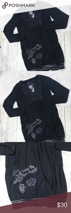 "Desigual Tunic Top Dress Love to Be Happy Crochet Desigual Women's Dress/Tunic Top.  Size 40/10.  Black.  Embroidered with ""I Love To Be Happy.""  Pockets.  V Neck with crochet detailing.  No care/materials tag.  In good, preowned condition with no flaws noted.  No trades, offers welcome.  Measures approximately 18"" pit to pit, 34"" shoulder to hem. Desigual Tops Tunics"