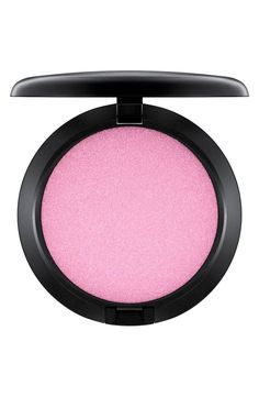 This iridescent pressed powder by MAC will add the perfect pop of pink to the cheeks.