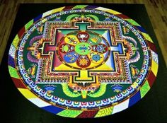 Tibetan monk sand mandala