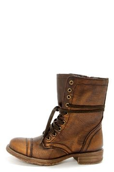 Check it out from Lulus.com! Prep your steps in time for boot season with the irresistible Very Volatile Chimney Bronze Lace-Up Combat Boots! Supple vegan leather creates a burnished, round-toe upper in an almost-neutral metallic bronze, that adds just the amount of play to your outfit. Brown laces climb through brass grommets up a 7.25