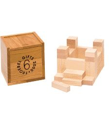 Froebel's Gift 6 again divides the three-inch cube into more varieties of rectangular prisms, including 18 oblong blocks, 12 flat square blocks (caps), and 6 narrow columns.