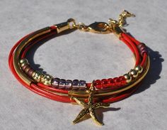 Nautical Strands Red Leather Strand Bracelet w Starfish Charm, Coastal Bracelet, Leather Bracelet,Sea Life Jewelr by SeaSideStrands on Etsy https://www.etsy.com/listing/183061066/nautical-strands-red-leather-strand