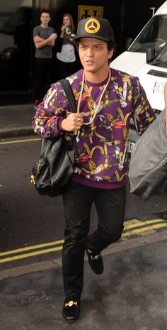33b0a4c072 Bruno Mars was spotted in a  Versace FW16 printed sweatshirt that he  matched with a