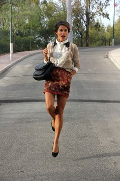printed skirt, tucked cardigan