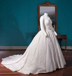 This simple but stunning dress comprised of a fitted bodice and a full fine diaphanous silk skirt was worn by HRH Princess Margaret when she married Lord Snowdon in 1960.  Historic Royal Palaces