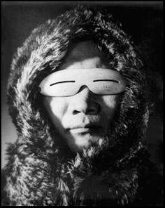 Inuit man wearing bone goggles - no date