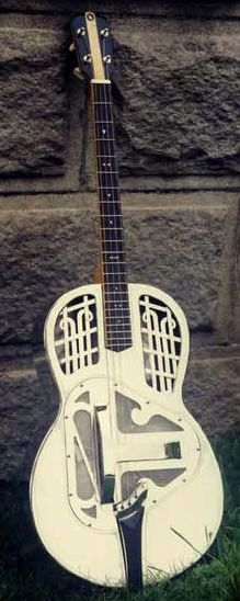 Metal Stringed Instruments tricone Tenor Guitar --- https://www.pinterest.com/lardyfatboy/