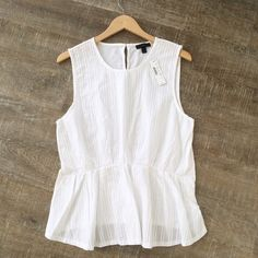 NWT! J. Crew 100% cotton sleeveless top Perfect top for work, or a day on the town! NWT J. Crew sleeveless top. 100% cotton. Size L. Offers welcome! J. Crew Tops