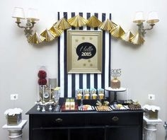 Gold and black New Year's party dessert table!  See more party planning ideas at CatchMyParty.com!