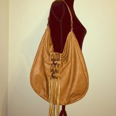 Mossimo tan boho purse. Tassels. Great condition. Mossimo tan boho purse. No stains inside. Has tassels. Beads. Mossimo Supply Co Bags Shoulder Bags