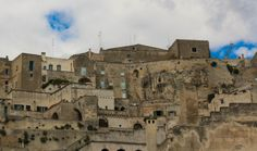 A view of Matera's Sasso Caveoso where ancient caves were converted into hillside dwellings. Visit Matera Italy