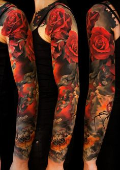 Roses for days on this sleeve. Love the darkness of the sleeve with the mix of red. Don't care for the spider that's creepin on the bottom. Lol.