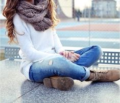 White sweater, faded jeans, beige boots, and a light brown scarf