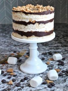 Tender vanilla cake layers, toasted marshmallow filling, toasted graham crackers pieces and chocolate ganache will remind you of the classic Moon Pie.