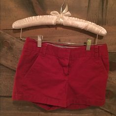 "Crimson red j crew chino shorts. size 00 NWOT size 00 crimson red chino's. 3"" seam. really cute and great for summer and spring. look good with wedges, heels, sandals or sneakers! offers always welcome :) J. Crew Shorts"
