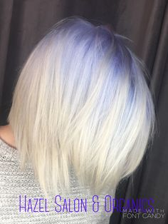 Platinum blonde with a purple root shadow