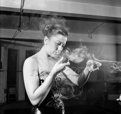 Parisian singer, Anny Berryer, preferred pipe smoking to cigarettes. September 1953