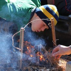 A scout stokes his fire during a competition at a camporee at Camp Kingsley, Ava, NY on Saturday, October 13, 2012.