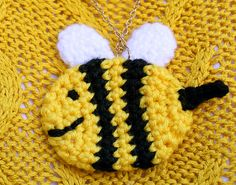 Bee Pin - Free Amigurumi Pattern here: http://blog.twinkiechan.com/2013/11/02/free-crochet-pattern-wiwt-bee-and-puppycat/
