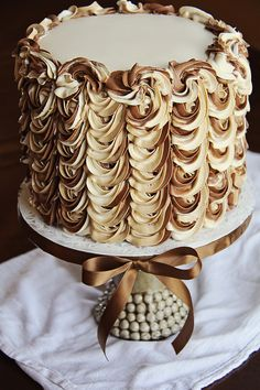 Tiramisu Cake finished in a swirl of 3 flavor buttercream swags (Vanilla, Coffee and Chocolate) by Three Little Blackbirds