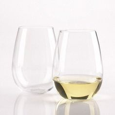 "'U' Stemless Chardonnay Wine Glass (Set of 2) by Wine Enthusiast. $19.34. 703 13 02 Features: -Chardonnay wine glass.-Material: Glass.-Mouth-blown of fine quality lead-free glass and because they're stemless.-Fits easily in your cabinets and dishwasher.-Perfect choice for casual entertaining and everyday enjoyment.-Capacity: 14 oz.. Dimensions: -Overall dimensions: 4.25"" H x 2.13"" Dia."
