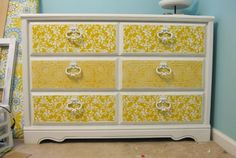Redo instructions for an old dresser. This one uses fabric or paper to cover the drawer fronts. Modpodge