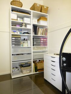 Ikea storage in my small printmaking studio. The large shelf unit has drawers and movable shelves for all my art materials and tools; the mobile drawer unit is used for papers and drawing pads and can be wheeled across the room to underneath a work table when I am printing. My intaglio press has also been fitted with industrial casters which gives me more flexibility in how I use limited space.