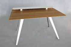 D117 is a minimalist design created by New York-based designer David Hsu. The desk has a solid rift-sawn white oak top surface. The designer integrated a secondary surface as an area to place peripherals and monitors. There is also an integrated cable chamber in which both power and USB can be charged directly within the desk. (5)