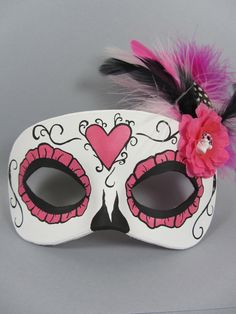 Pink Day of the Dead Heart, Skull, and Flower Leather Masquerade Mask. $45.00, via Etsy.