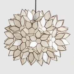 Handcrafted by skilled artisans in the Philippines, our Large or Small Capiz Lotus Hanging Pendant Lantern features white capiz seashells formed into a gorgeous flower ball. The hand-collected natural capiz shells glow with a warm radiance when il. Decor, Capiz, Pendant Chandelier, Lanterns, Hanging Pendants, Pendant Lamp, Flower Chandelier, Hanging Pendant Lantern, Flower Pendant
