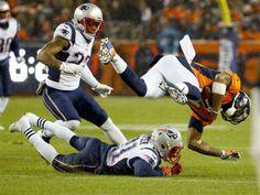 New England Patriots cornerback Malcolm Butler (21) hits Denver Broncos wide receiver Cody Latimer (14) during the first half of an NFL football game, Sunday, Nov. 29, 2015, in Denver.
