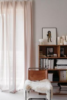 pale pink curtains with tan leather and chrome chair with faux fur throw. / sfgirlbybay