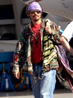 PLANE CLOTHES  Johnny Depp, still sporting his Jack Sparrow bandana and gold teeth, arrives in L.A. on Tuesday from the West Indies set of Pirates of the Caribbean: Dead Man's Chest. Credit: Bauer-Griffin  Updated: Wednesday Apr 20, 2005 | 06:00 AM EDT