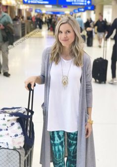 Best travel outfit ever! LuLaRoe perfect tee, leggings, and Sarah cardigan. Comfort in layers for the different temperatures of flying. Click to shop LuLaRoe or for more style inspiration!