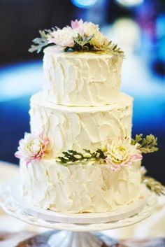 Beautiful wedding cake with simple flowers and cute wooden cake ...