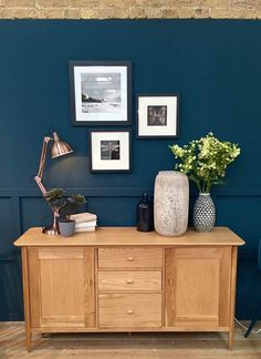 The Ercol Teramo Sideboard has been styled with copper and geometric accessories for a modern meets retro look.