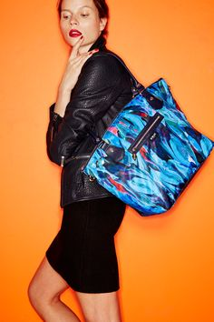 Beloved by busy women everywhere for their streamlined, stylish designs, @mzwallacenyc  ultra-functional nylon carryalls keep up with even the most action-packed schedules. This season the label gives its versatile Chelsea tote a gallery-worthy update in a vibrant watercolor print you won't find anywhere else.