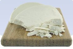 Mizithra or Myzithra is a traditional pasteurized cheese made from sheep's milk and some added cream and whey. The cheese is easy to cut, snow-white, creamy, and granular; its flavor is similar to Ricotta Salata and it an ideal cheese for grating.