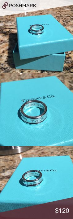 925 TIFFANY 1837 RING the Tiffany authentic 1837 collection is defined by sleek curves and contours. This elegant ring embodies a timeless aesthetic. Gently used.  Sterling silver Medium. 5 1/2 Tiffany & Co. Jewelry Rings